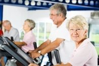 Older Woman and Man on Treadmill