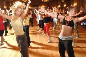 Group performing exercise to music