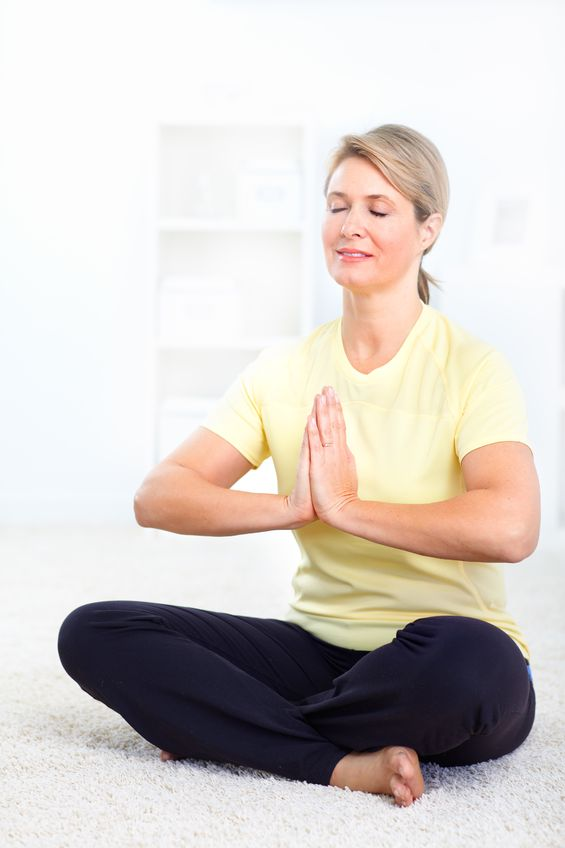 older woman performing yoga