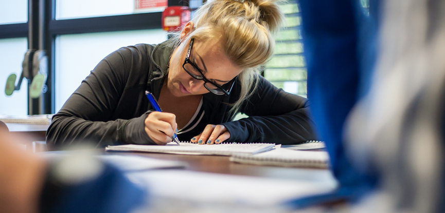 A student studying for her fitness qualification