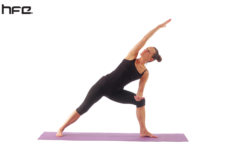 Female performing an extended side angle pose for low back pain