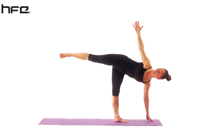 Female performing a half moon yoga pose for low back pain