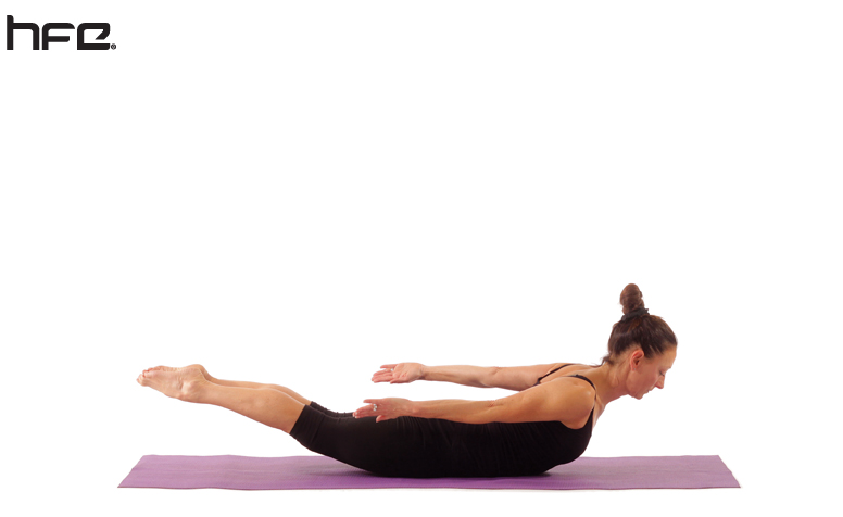Female performing a locust yoga pose for low back pain