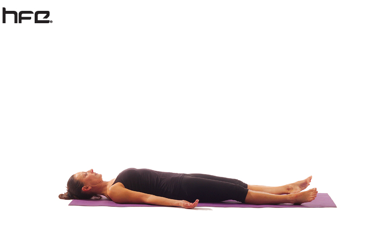 A female yoga instructor performing the Corpse Pose