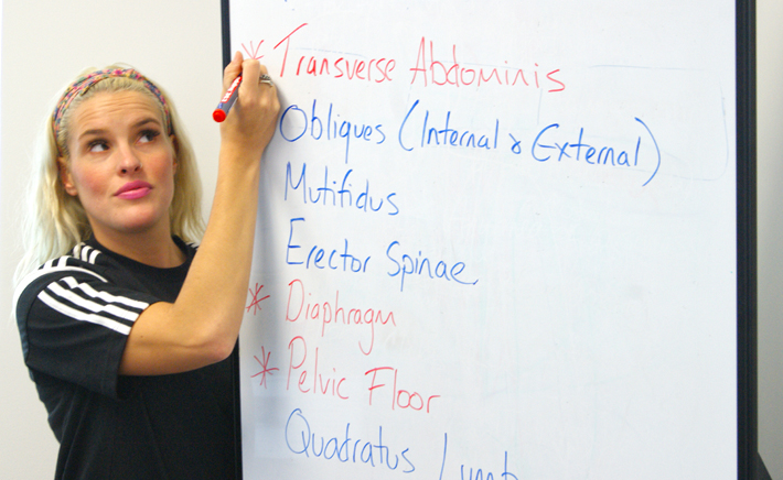Danielle Sharrock teaching at the whiteboard