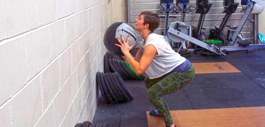Georgina demonstrating a rotational wall ball slam