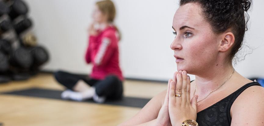 Adults attending a Pilates class