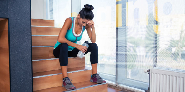 woman tired in gym gear