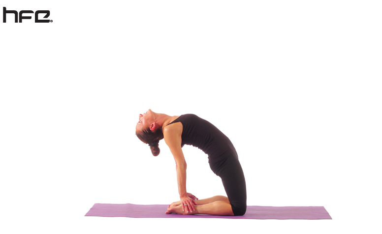 A yoga teacher performing a camel pose