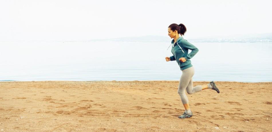 A female runner on a beach