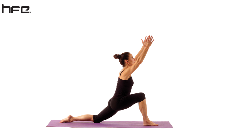 A yoga teacher performing the lunge pose