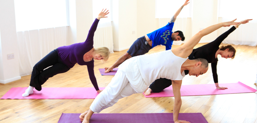 A group of participants attending a Pilates class