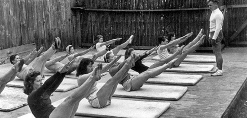 Joseph Pilates resides over a mat-based Contrology class