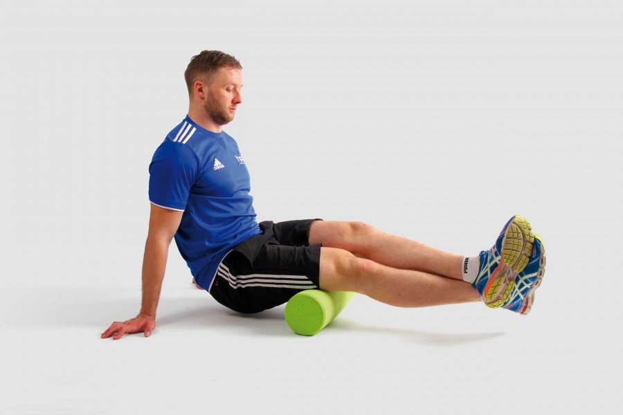 HFE tutor using a foam roller on the hamstrings