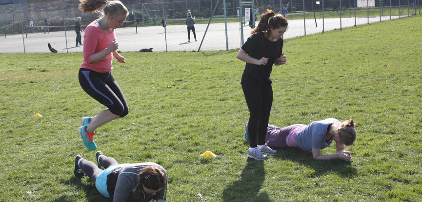 Jumping exercises at an outdoor bootcamp