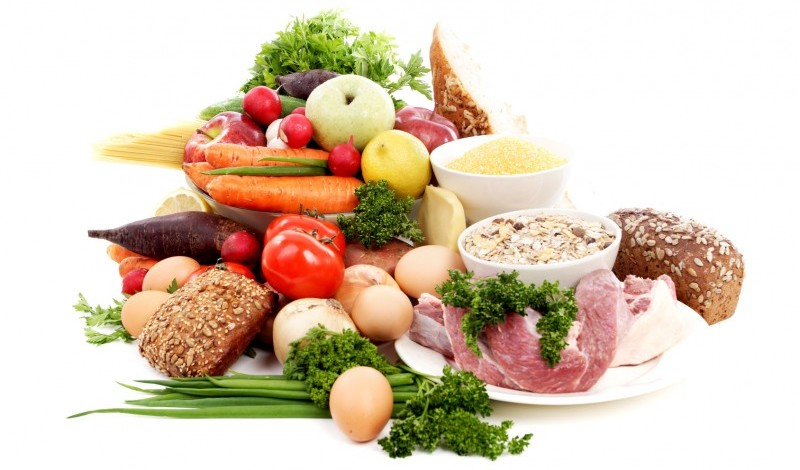 A selection of meat, fruit and vegetables containing protein