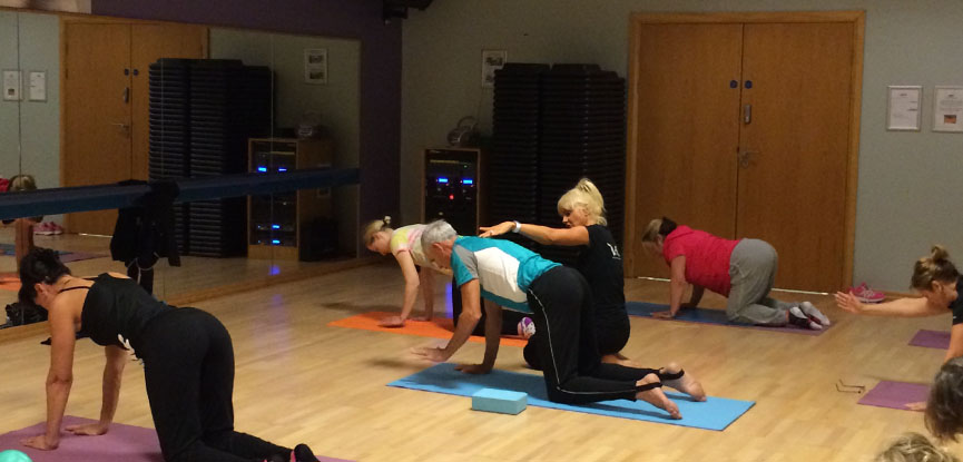 Ruth Hoyle, certified Pilates instructor teaching a class