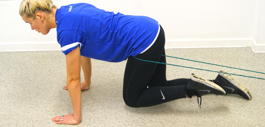 Support tutor Dani performs a hip floss exercise