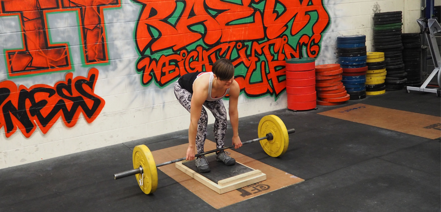 Fitness blogger Fitcetera demonstrates how to perform a deficit deadlift