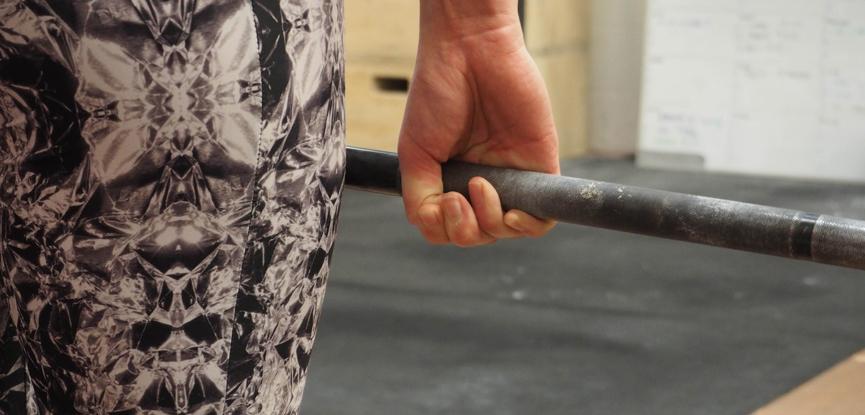Fitness blogger Georgina Ellis demonstrates a hook grip deadlift