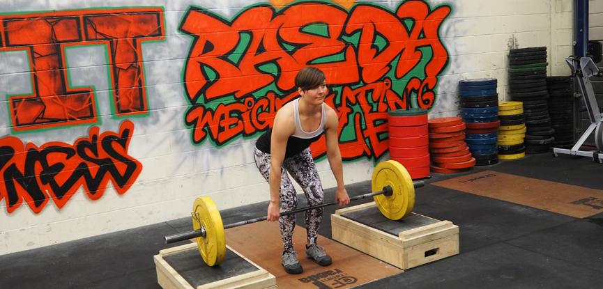 Fitness blogger Georgina demonstrates how to perform a rack pull deadlift