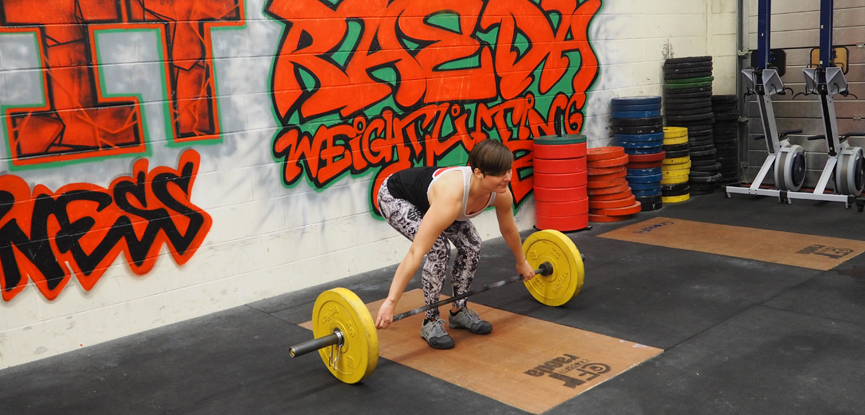 Georgina correctly performs a snatch grip deadlift
