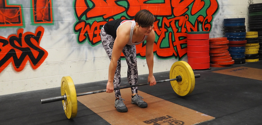 Fitness blogger Georgina demonstrates a stiff-legged deadlift
