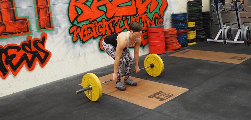 Georgina demonstrates the conventional grip for a deadlift
