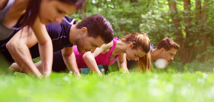 Participants taking part in an outdoor boot camp