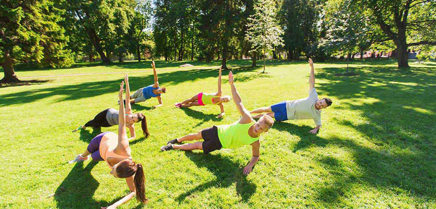 A group taking part in an outdoor fitness class