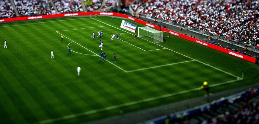 tilt shift image of a football match