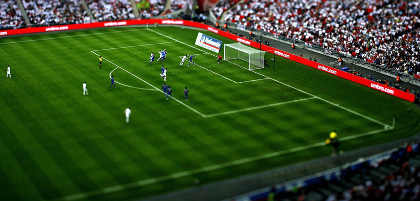 tilt shift image of a football match