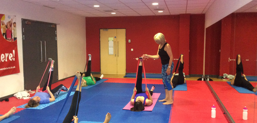 HFE graduate Maureen teaching a Pilates class