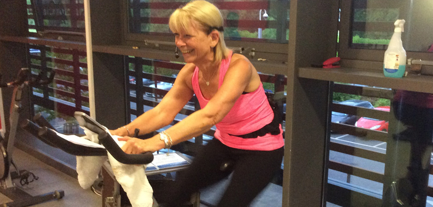 HFE student Maureen teaching a spinning class