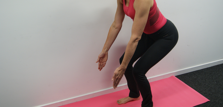 The Pilates monkey squat is ideal for helping low back pain