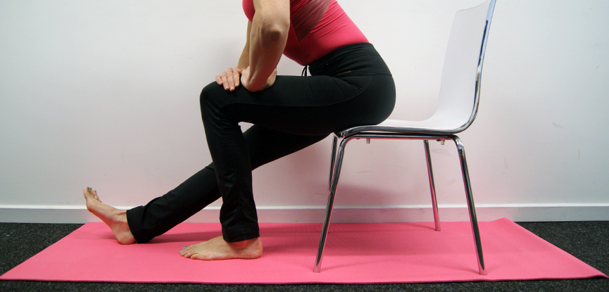A chair can also be used to stretch the hamstring and improve low back pain