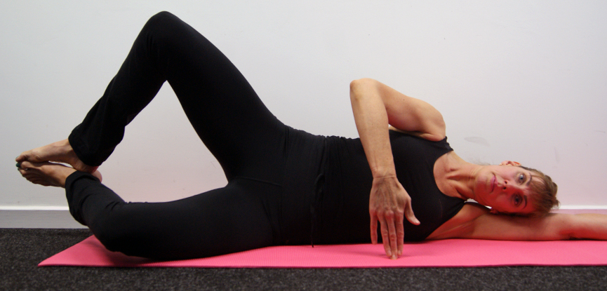 An adapted oyster or clam Pilates pose for older adults