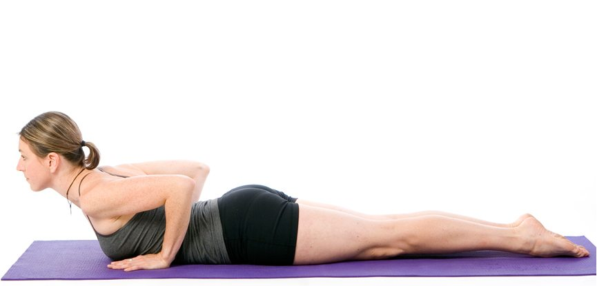 Sally Parkes performs the cobra pose for a healthy spine