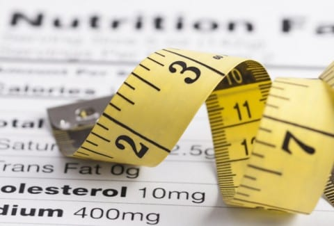 Nutrition fact sheet with a tape measure