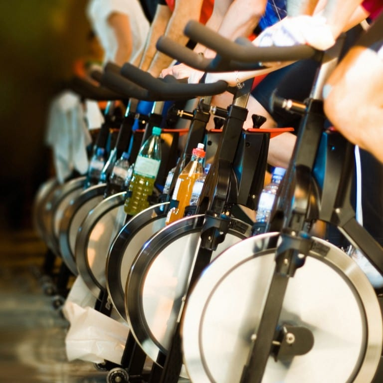 A class taking part in an indoor cycling class