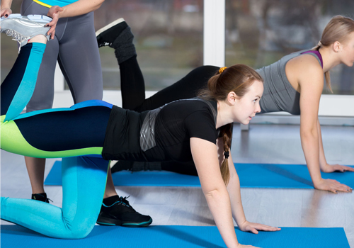 Back pain specialist assisting a client with an exercise