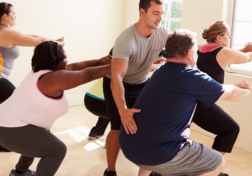 Exercise specialist exercise working with obese clients