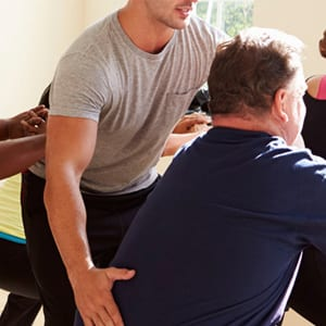 Exercise specialist working with obese clients