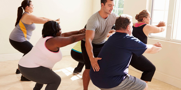 Group of overweight people exercising