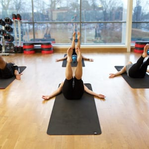 Qualified Pilates instructor leading a freelance class