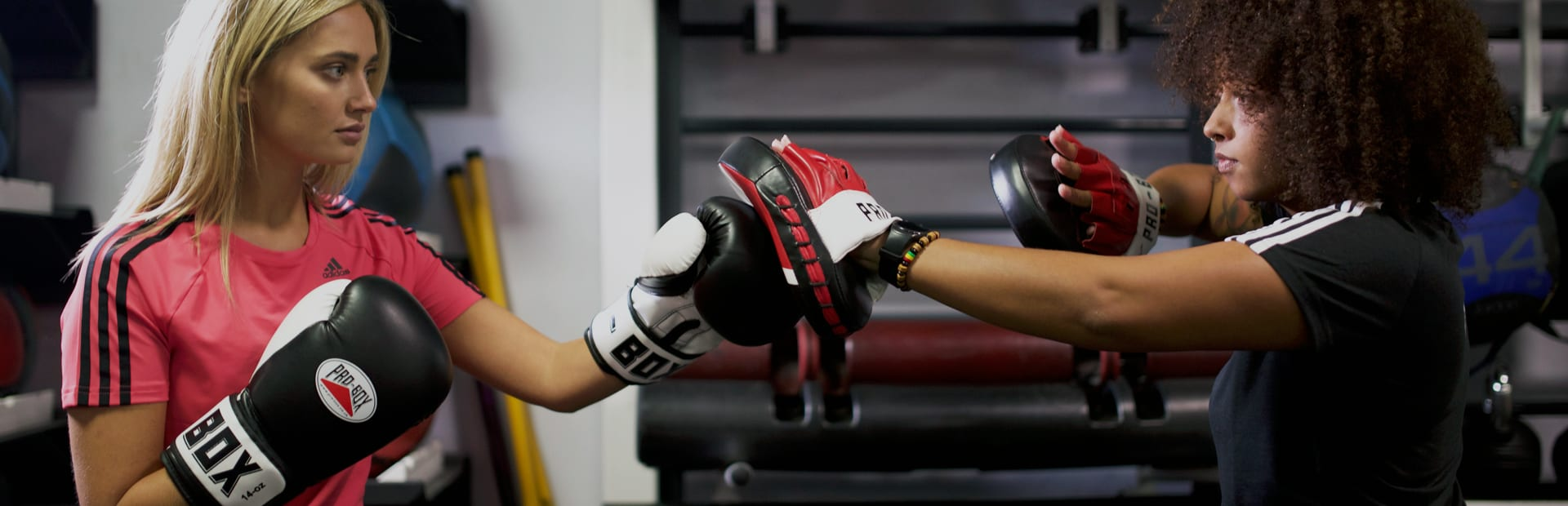 Qualified personal trainer performing boxing exercises with a client