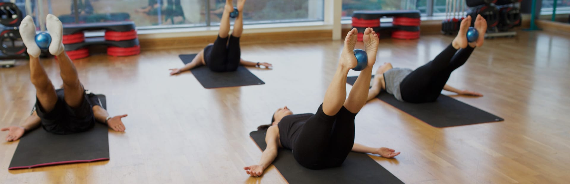Qualified Pilates instructor leading a class