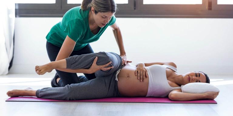 Pilates teacher with pregnant woman