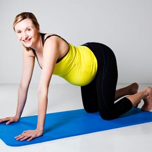 Pregnant client on an exercise mat