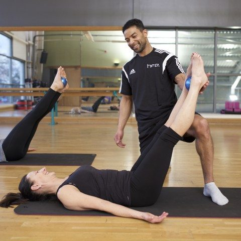 HFE Pilates instructor working with a student